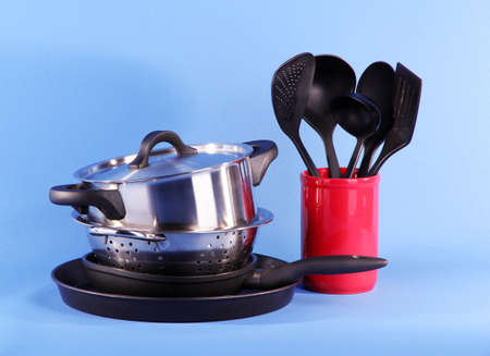 kitchen tools on blue background photo