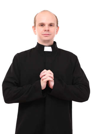 reverent: Young priest isolated on white