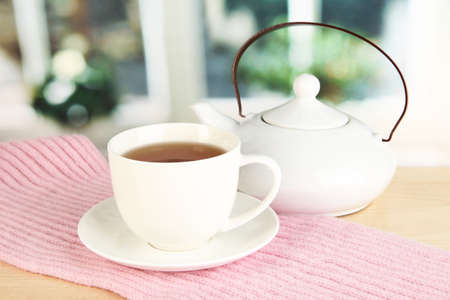 cup of tea with scarf on table in room Stock Photo - 17569474