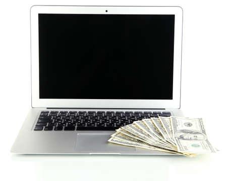 Money on laptop isolated on white Stock Photo - 17541143