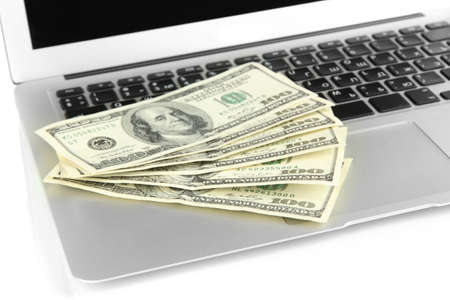 Money on laptop isolated on white Stock Photo - 17569092