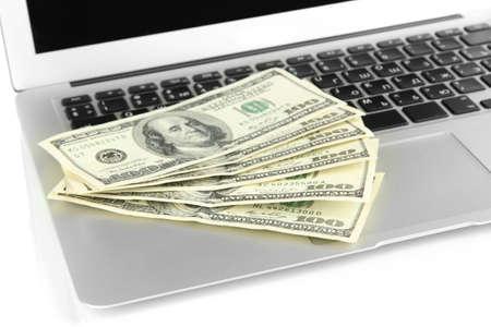 Money on laptop isolated on white Stock Photo - 17569092