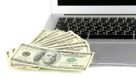 Money on laptop isolated on white Stock Photo - 17568963