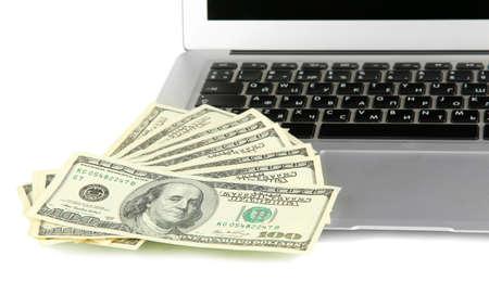 Money on laptop isolated on white Stock Photo - 17568963