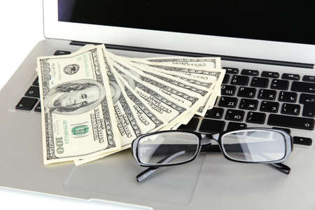 Money with glasses on laptop close-up Stock Photo - 17571554