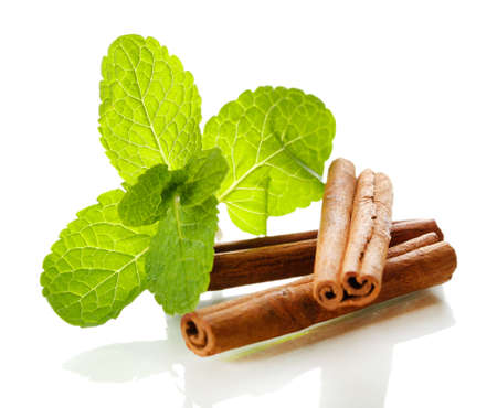 Mint with cinnamon isolated on white photo
