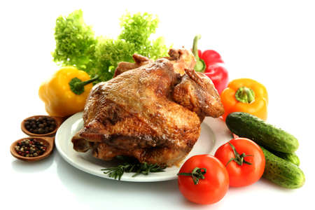Tasty whole roasted chicken on plate with vegetables, isolated on white Stock Photo - 17569027