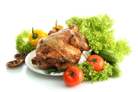 Tasty whole roasted chicken on plate with vegetables, isolated on white Stock Photo - 17569425