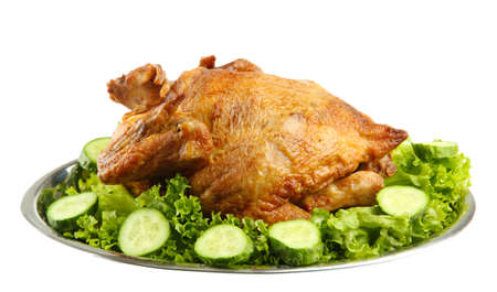 Tasty whole roasted chicken on plate with vegetables, isolated on white Stock Photo - 17541897