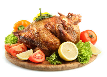 Whole roasted chicken on wooden plate with vegetables, isolated on white Stock Photo - 17541908