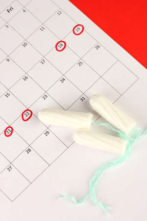 menstruation calendar with cotton tampons, close-up Stock Photo - 17578374