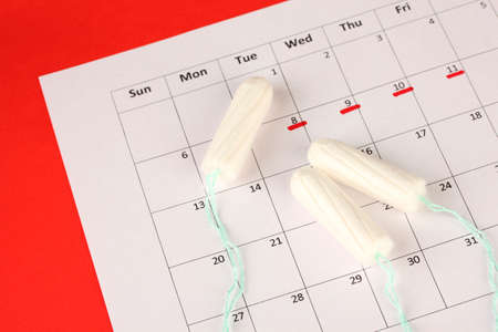 menstruation calendar with cotton tampons, close-up Stock Photo - 17578333