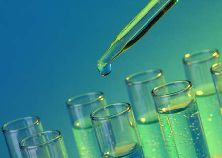 test-tubes with liquid on blue background Stock Photo - 17578326