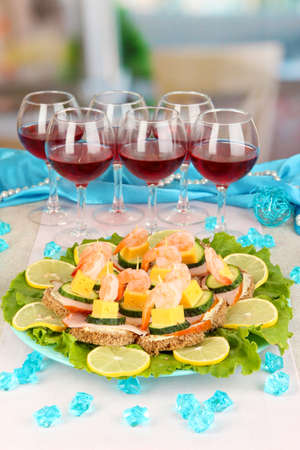 Canapes and wine in restaurant photo