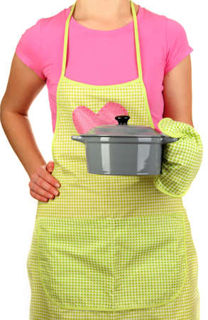 homemaker: Closeup of  homemaker in apron  holding  pan isolated on white