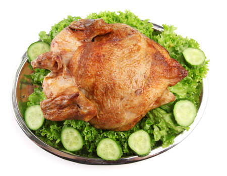Tasty whole roasted chicken on plate with vegetables, isolated on white Stock Photo - 17578377