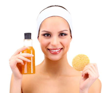 Young woman cleansing her face with scrub, isolated on white photo