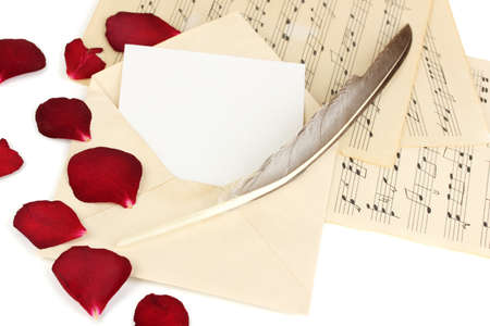 Old envelope with blank paper and dried rose petals on music sheets close up Stock Photo - 17599253