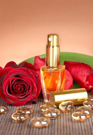 Women's perfume in beautiful bottle with rose on brown background Stock Photo - 17656922