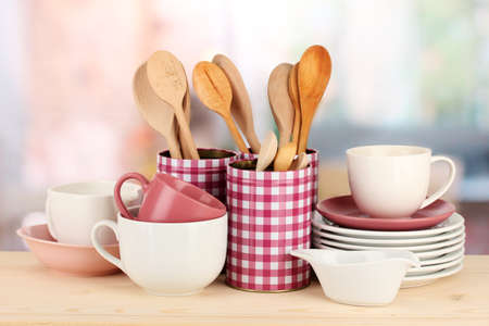 Cups, bowls nd other utensils in metal containers isolated on light background Stock Photo - 17656742