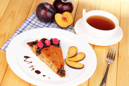 Tasty pie on plate on wooden table Stock Photo - 17682938
