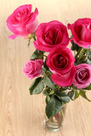 Beautiful pink roses in vase on wooden table close-up Stock Photo - 17682100