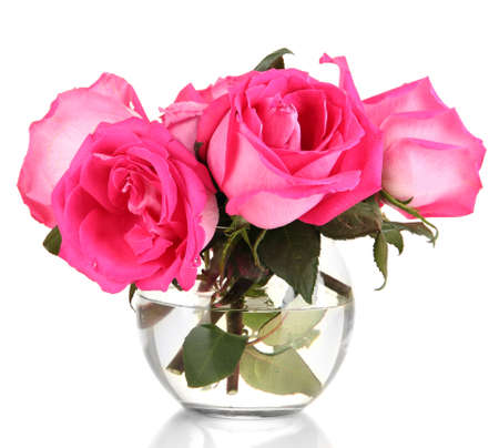 Beautiful pink roses in vase isolated on white photo