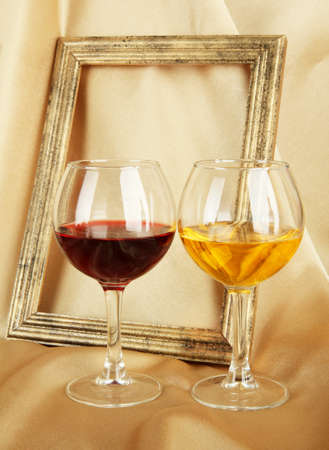 composition of frame and wine on bright background photo