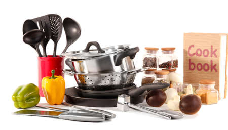 kitchen appliances: composition of kitchen tools,spices and vegetables isolated on white