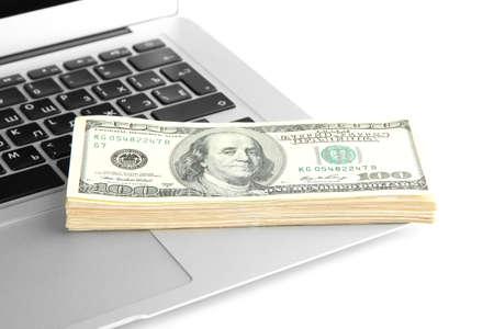 Money on laptop isolated on white Stock Photo - 17676804