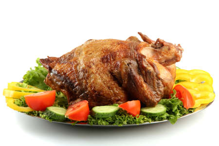 Tasty whole roasted chicken on plate with vegetables, isolated on white Stock Photo - 17676819