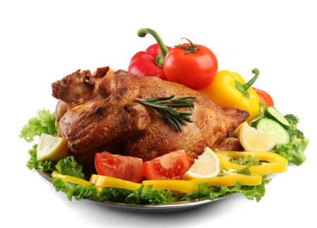Tasty whole roasted chicken on plate with vegetables, isolated on white Stock Photo - 17674679