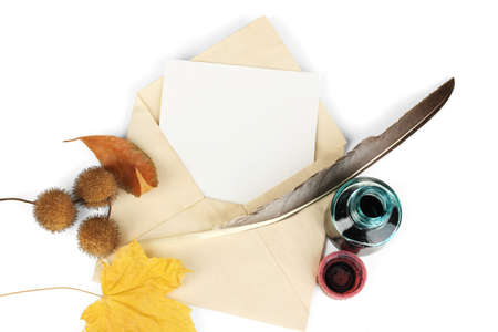 Old envelope with blank paper and autumn leafs isolated on white Stock Photo - 17673735