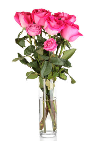 Beautiful pink roses in vase isolated on white Stock Photo - 17661984