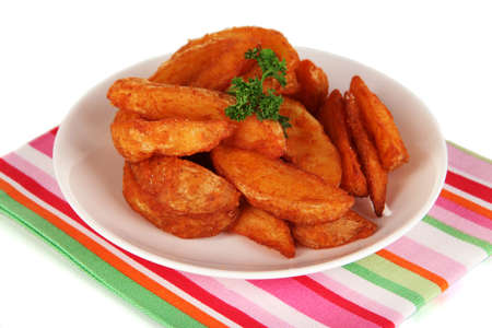 nutritiously: Appetizing village potatoes on plate isolated on white