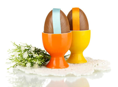 Chocolate eggs in stand isolated on white photo