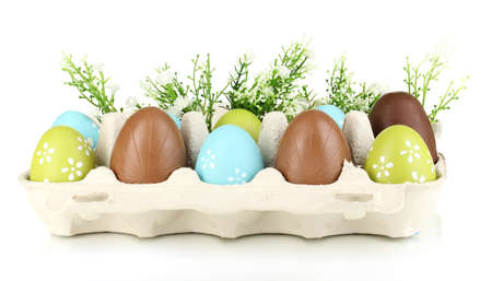 elliptic: Easter and chocolate eggs in paper box for them isolated on white