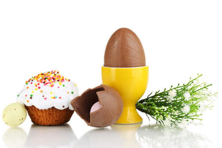 Composition of chocolate eggs and Easter cake isolated on white photo