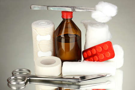 First aid kit for bandaging on grey background photo