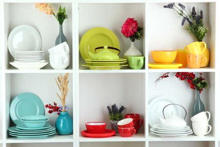 vitrine: Beautiful white shelves with tableware and decor  Stock Photo