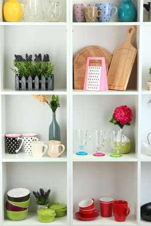 Beautiful white shelves with tableware and decor  Stock Photo - 17663407