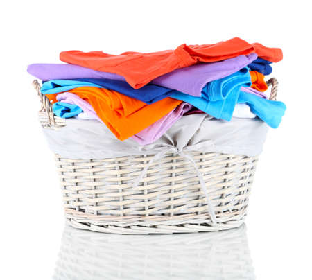 Clothes in wooden basket isolated on white Stock Photo - 17663057