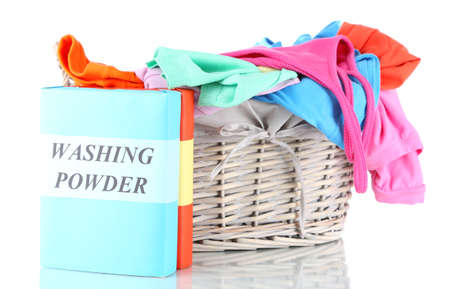 Clothes with washing powder in wooden basket isolated on white Stock Photo - 17656087