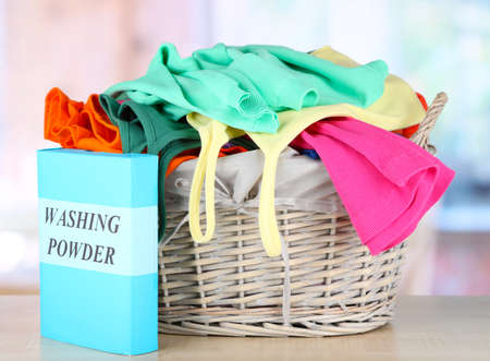 Clothes in wooden basket on table in room Stock Photo - 17656110