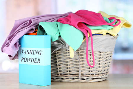 Clothes in wooden basket on table in room Stock Photo - 17663427