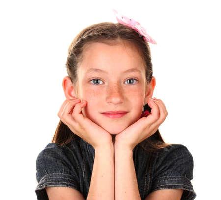 grade schooler: Portrait of beautiful little girl. Isolated on white