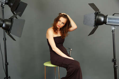beautiful professional female model resting between shots in photography studio shoot set-up Stock Photo - 18039883