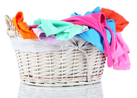 Clothes in wooden basket isolated on white Stock Photo - 17704686