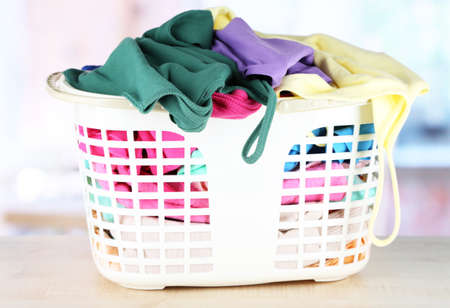 Clothes in plastic basket on table in room Stock Photo - 17704684