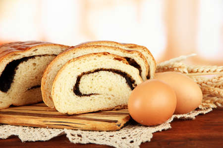 Loaf with poppy seed on cutting board, on bright background Stock Photo - 17704945